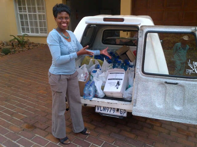 Miriam with the supplies kindly donated during the floods