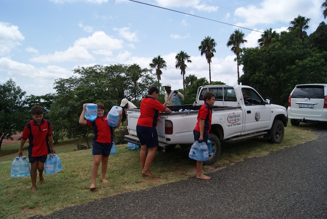 volunteers delivering much needed water during the floods