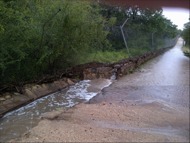 roads outside the hoedspruit endangered species centre that have been severely affected by floods