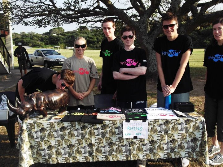 volunteers for the preservation of rhinos fundraising, by selling t shirts