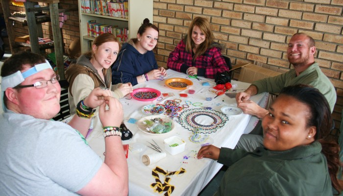 volunteers work with beads at the Addo old age home
