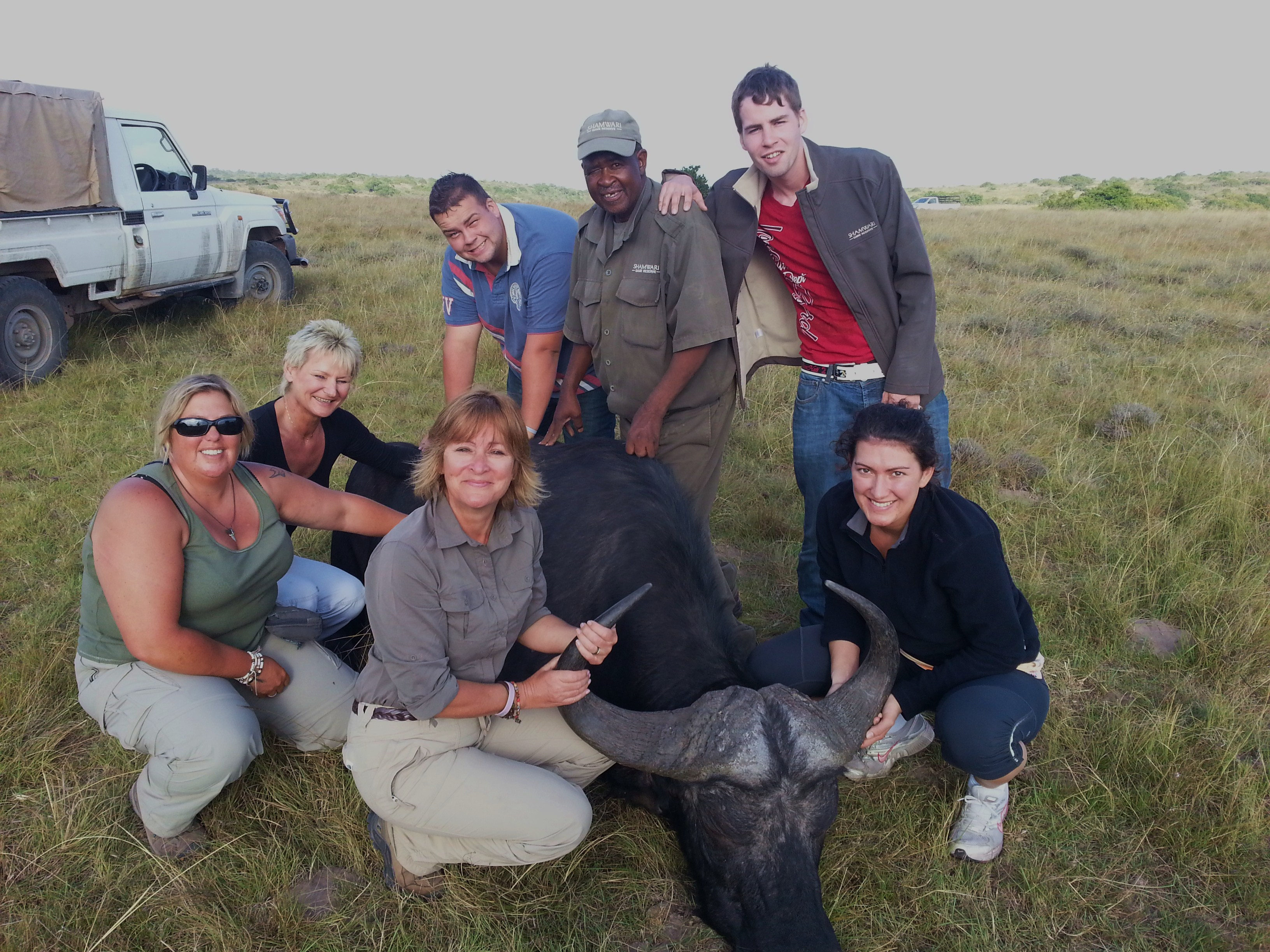Volunteers and Shamwari staff pose with a buffalo captured for testing