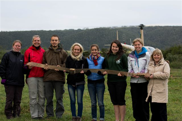 volunteers at the Kariega conservation volunteer program with a helicopter in the background