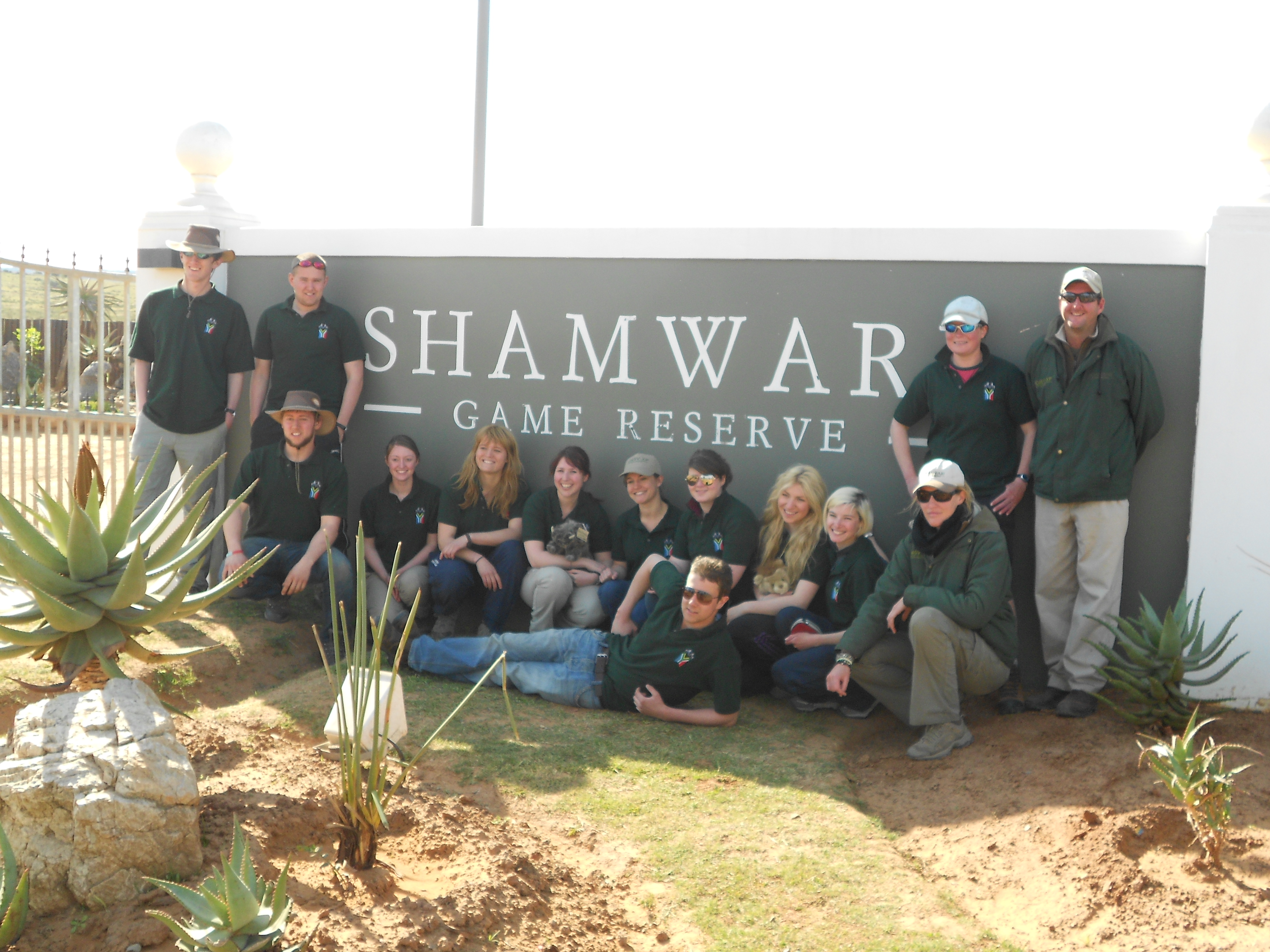 volunteers pose with the Shamwari Game Reserve sign