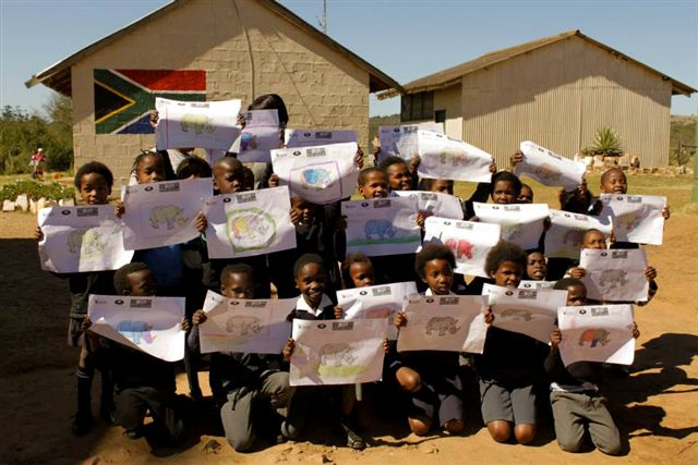 Locals of the Kariega community show off their rhino drawings