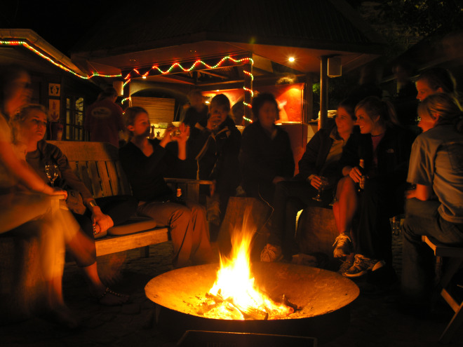 Volunteers enjoy a campfire and laughter