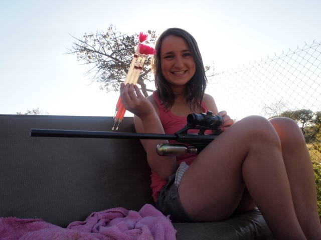 A volunteer and a darting gun