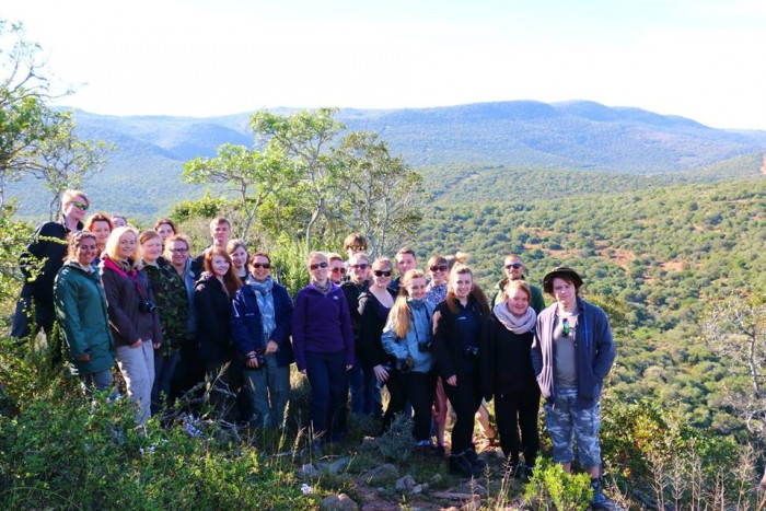 SGS volunteers pose at the top of a hill at the Shamwari conservation experience