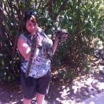 A volunteer handing a large snake at HESC