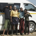 A South African community take a picture near a dump site
