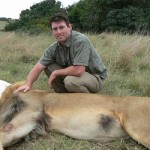 Amakhala vet with a blindfolded lion