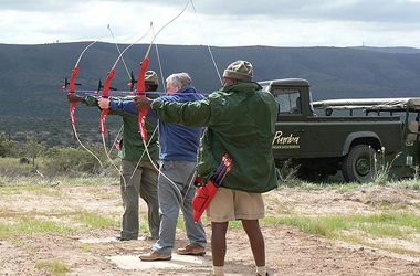 Game rangers with a bow and arrow