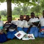 Young school children show off their books on Vietnam