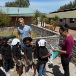 Volunteers playing with school children
