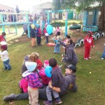 Local school children playing with volunteers