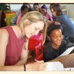 Volunteers answer a quiz with local school children