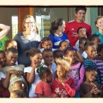 Volunteers and school children in a group picture