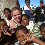 Local children share a picture with a volunteer