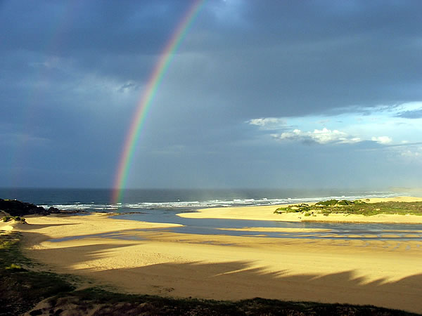 A rainbow on a beach in South Africa