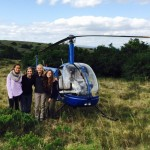 Volunteers posing with the Shamwari helicopter