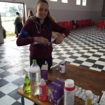 "A ""Pre"" Vet Eco Experience volunteer prepares medication for local's pet cats and dogs"