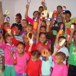 Children show off their easter egg baskets they made