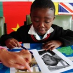 A local child looking at pictures