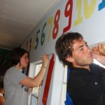 Volunteers painting walls in a school