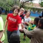 Volunteers high five school children
