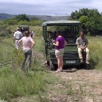 Volunteers take a break from working near the Shamwari truck