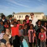 Volunteers with local school children