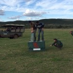 "volunteers on the ""Pre"" Vet Eco Experience release a cheetah into the wild"