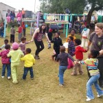 Volunteers dancing with local school children