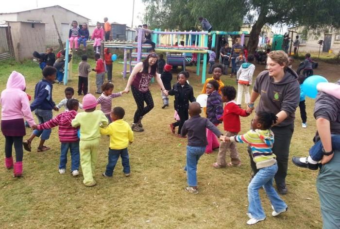 Volunteers dancing with local school children