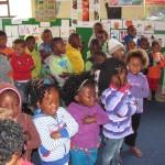 School children standing in their class room