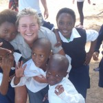 Some of the kids cuddle up with a volunteer