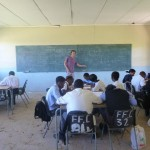 A volunteer teaching a class