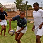 Teenage boys playing rugby