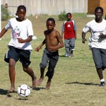 Local youths running with a football