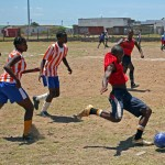 A group of local youths playing football
