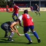 Young men playing hockey