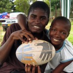 A member of the local community holding a rugby ball